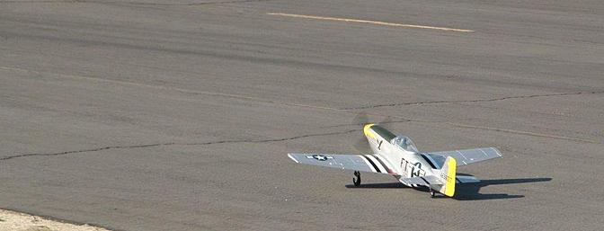 The Mustang is shown taxiing toward its date with a video camera.