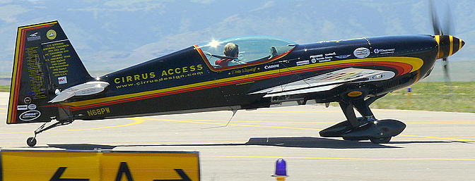 The great Patty Wagstaff prepares a full-scale Extra 300S for takeoff.  Photo:  Wikimedia Commons