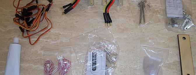 The motors are shown here already mounted to their brackets.  Shown too are the contents of the hardware bag and other miscellaneous items including the LEDs for the wingtips.