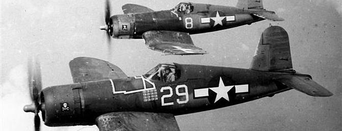 A formation of F4U-1A aircraft from Navy squadron VF-17 or <i>Jolly Rogers</i> flies over the Southwest Pacific.  (Photo:Wikimedia Commons)