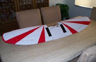 Newly assembled wing photographed on my formal dining room table to give you an idea about the size of this plane.