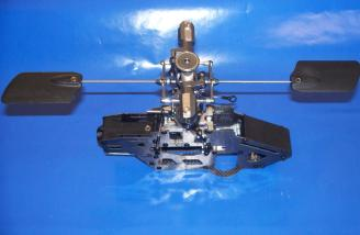 Test-fitting the main rotor with the newly installed flybar and paddles was simple; the factory-assembled frame was nicely aligned.  In practice, the thicker of the two shims which fit between the retaining collar and the upper bearing is necessary to properly align the shaft and drive gears with the frame and motor.