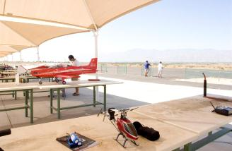 The chopper and the Airtronics SD-6G await their turn at the Coachella Valley R/C Club's helicopter pad.