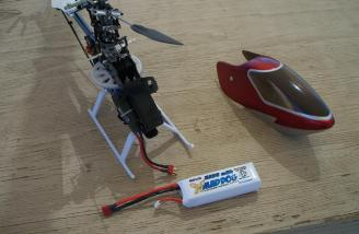 The Mad Dog and the 450TT Pro are being readied on the helipad bench at the Coachella Valley Radio Control Club.