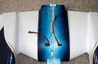 Looking at the other side of the wing shows the battery leads for each ESC poking through.  The blue stripe down the center looks as if it's incomplete, but only the outer edges show once the wing is installed.