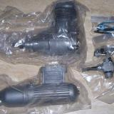 Engine, muffler and carb await unwrapping and installing.  The package on the upper right holds the hardware for remotely installing the high-speed needle valve.