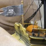 And what pirate ship worth its salt wouldn't be flyin' the Jolly Roger from the stern?