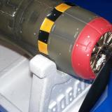 The adapter necessary to mate the propeller to the gearbox's spur gear can be seen just behind the propeller's hub.  Note the inrunner's drive gear.
