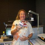 Radio control meets radio broadcasting:  Brad Mercer is a guitarist, singer, composer, full-scale pilot and the afternoon drive personality on classic rocker KMRJ-FM Palm Springs, aptly nicknamed