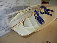 Name: DSCN3537.jpg Views: 43 Size: 752.7 KB Description: Even the balsa was difficult to lay against the very tight curves of the bow.  I had to use filler planks several times.  Should be interesting to see how I make the mahogany fit.