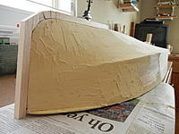Name: DSCN3559.jpg Views: 40 Size: 759.0 KB Description: I used indoor/outdoor wood filler from hardware store to get a smooth surface.  I also used balsa block to create a really sharp bow/cutwater--like the Chris Craft.