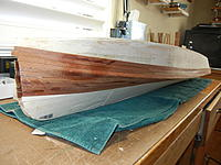 Name: DSCN3632.jpg Views: 34 Size: 824.2 KB Description: Notice I've installed mahogany planks ONLY where they will shoe in finished model.  Since this photo was taken ALL mahogany has been installed--about 20 hrs. I will now sand and then decide whether to use 2 part epoxy with or without fiberglass cloth