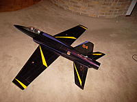 Name: SAM_1011.jpg Views: 74 Size: 209.7 KB Description: Plane is painted in metallic maroon and trimmed in yellow and purple. Really hard to see