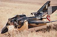 Name: Eds JMP F4 7 001 (1024x668).jpg Views: 129 Size: 384.6 KB Description: Aftermath of the flight when the plane was bellied in on the top of a dirt mound. Plane was repaired and flew again many times. Finally sold it to some one in Texas in 1997 or 98.