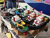 Name: IMG_0189R.jpg Views: 27 Size: 188.0 KB Description: Our club tug boats that we let the public use.  Keeping them running is a job.