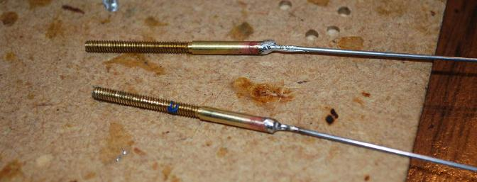 The solid wire pushrods and threaded ends were added.