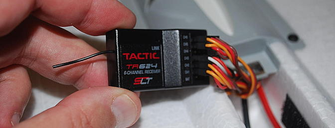 Tactic receiver is included.  Anylink makes that work with most popular transmitter brands.
