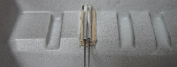 Here the pushrod tubes enter the radio area.  A small scrap of balsa was used to secure the ends of the tubes.  DO NOT omit gluing the ends of the pushrod tubes in place.  They must be attached for proper elevator function.