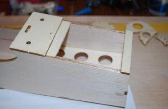 A lite-ply piece was applied on top of the fuse sides by the firewall to create a latch for the hatch tab.