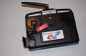 The single 1s pack connected and being charged, as indicated by the yellow lamp.
