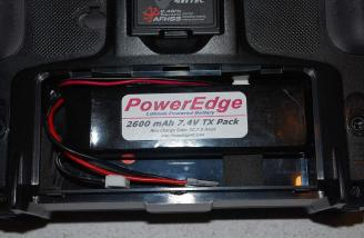 A quick cut of the hobby knife had the foam piece modified and the excess was used to secure the small PowerEdge battery from shifting and sliding around.