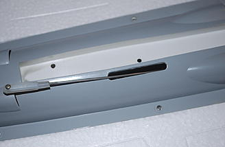 Make sure you slide the push-rod through the slot for the rudder linkage.