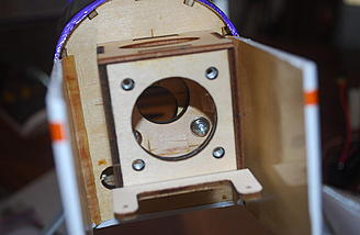 The screws are secured through the front blind nuts - a job for a thin screwdriver.