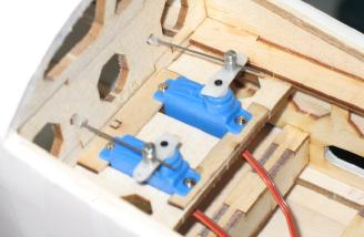 Servos mounted in the fuselage.