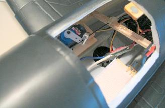 Here you can see the servo and the added balsa for securing the pushrod tube end, as Mike described above.