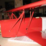 Attaching the top wing to the center.