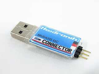 USB to 5V serial adapter. Use a servo extension lead to connect to the device to be programmed.