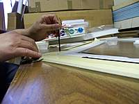 Name: 100_5221.jpg Views: 795 Size: 56.7 KB Description: Pushing the spars down into the epoxy.