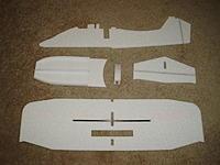 Name: PB230267.jpg Views: 481 Size: 159.6 KB Description: Glue in spar in wing. Hinge elevator and rudder. Glue stringers on to upper float plate. Laminate motor box.