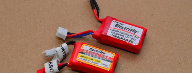 The original flight battery next to the new, higher capacity battery.