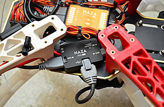 The GCU connects to the NAZA M V2's spare can bus port using the included cable.