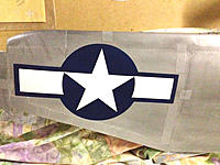 Name: IMG_8275.jpg Views: 156 Size: 300.7 KB Description: The insignia on the top of the wing. Look at all the paint damage caused by the masking and alignment tape