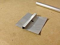 Name: IMG_8450.jpg Views: 122 Size: 245.6 KB Description: Bent up a protecting lining for the balsa inside the battery hatch from an aluminium can. This will be epoxied inside so the allen key won't do any damage