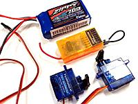Name: step17.jpg Views: 716 Size: 39.3 KB Description: STEP 18 Round up your electronics. These are the ones I like to use. Ad some control horns, linkages and mount your servos with hot glue or just tape them in.