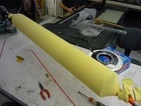 Name: Set up kevlar (Large).jpg Views: 170 Size: 91.2 KB Description: Kevlar sock on tube ready for epoxy.