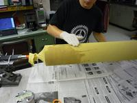 Name: applying epoxy2 (Large).jpg Views: 228 Size: 101.0 KB Description: Me applying the West Systems to the Kevlar sock.