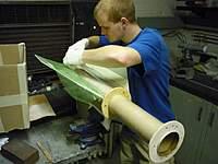 Name: P1020440 (Large).jpg Views: 220 Size: 88.9 KB Description: Applying fiberglass to motor tube/fin joints.
