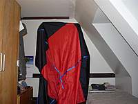 Name: me and chute (Large).jpg Views: 141 Size: 73.6 KB Description: That's me standing under the main parachute.  It's about 8 feet in diameter when opened as if descending.