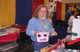Azarr was showing off GWS's latest piece of fun -- a bright pink transmitter for us lady pilots. ALRIGHT! Way to go GWS!