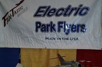 The Fan-Tastic Mig 15 indoor/moderate wind parkflier, hiding here below their booth banner, is 22.5