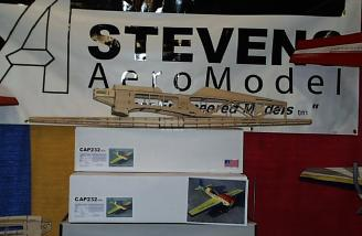 The Stevens Aero cap in bones in-front of their booth signage.