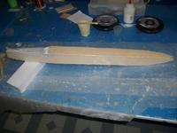 Name: Airframe almost done 001.jpg Views: 101 Size: 33.4 KB Description: fiberglassed balsa sheeted foam fuselage