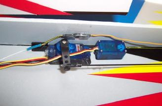 Tail servos and <b>provided, custom</b> servo arms.