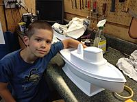 Name: image-9732f529.jpg Views: 64 Size: 807.3 KB Description: The still unnamed boat and the proud owner.