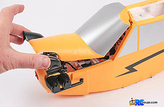 Lift up on the front of the cowl for easy access to the motor,  battery and receiver.