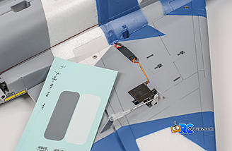 After plugging in the aileron servo, cover the connection with the color matched sticker provided